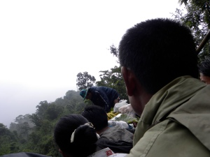 Sitting in the back of a truck - headed toward Mt. Kyaikhtiko