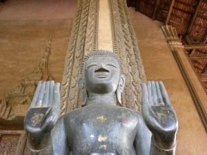 Stone Buddha image in double abhaya mudra - Ha Phreow