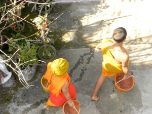 Novice monks doing chores at monastery - Luang Prabang