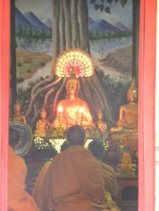 Evening prayer at temple - Luang Prabang