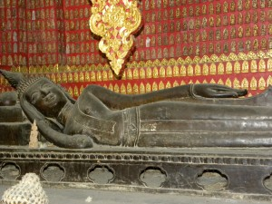 The reclining Buddha in the Red Chapel at Wat Xieng Thong