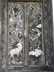 Stenciled door panel at Wat That Luang